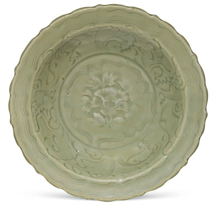 A carved celadon barbed rim dish, Ming Dynasty