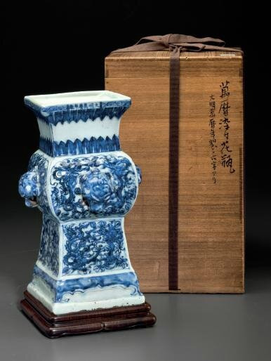 A very rare blue and white relief-molded vase, fanggu, Wanli six-character mark in underglaze blue in a line and of the period