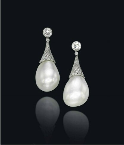 A pair of extremely rare natural pearl and diamond ear pendants