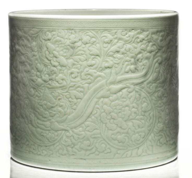 An incised celadon-glazed 'chilong' brushpot, Qing dynasty, Kangxi period