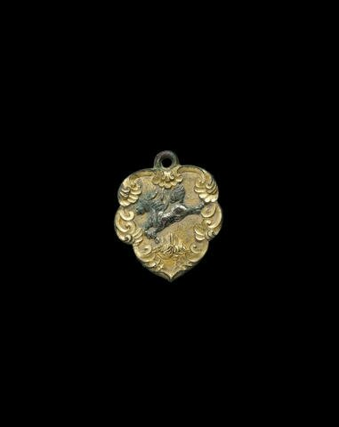 A silvered and gilt bronze horse harness ornament, xingye, Tang dynasty