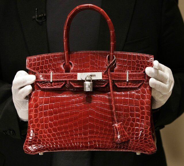 Hermes to probe, punish 'cruelty' to crocs used for handbags