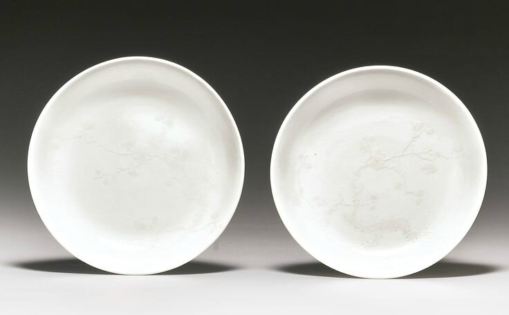 A rare pair of slip-decorated white-glazed dishes, Qing dynasty, 18th century1