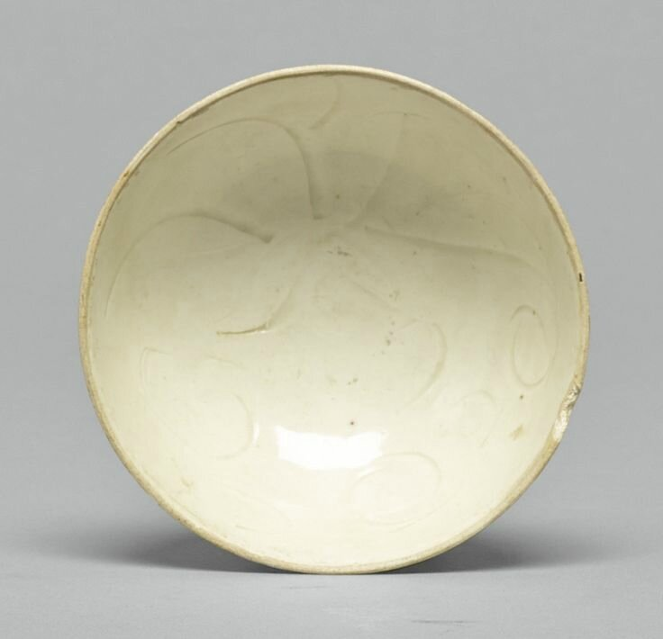 A small carved 'Ding' bowl, Song dynasty