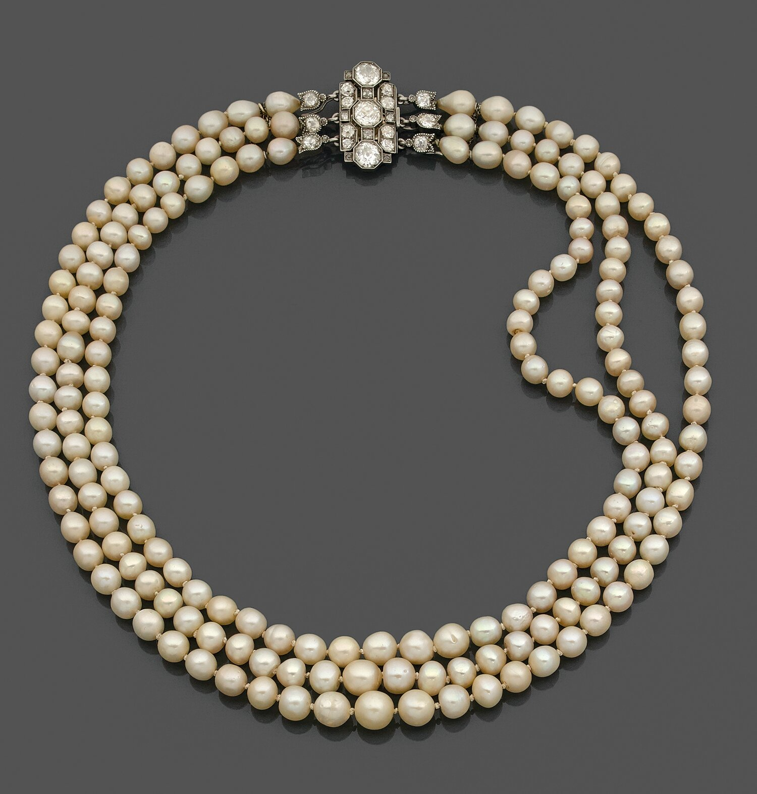 A natural pearl, diamond and platinum necklace, circa 1910.