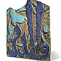 A monumental lustre pottery tile fragment, persia, 13th-14th century