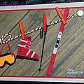 carte d'anniversaire avec matériel de ski sur corde à linge