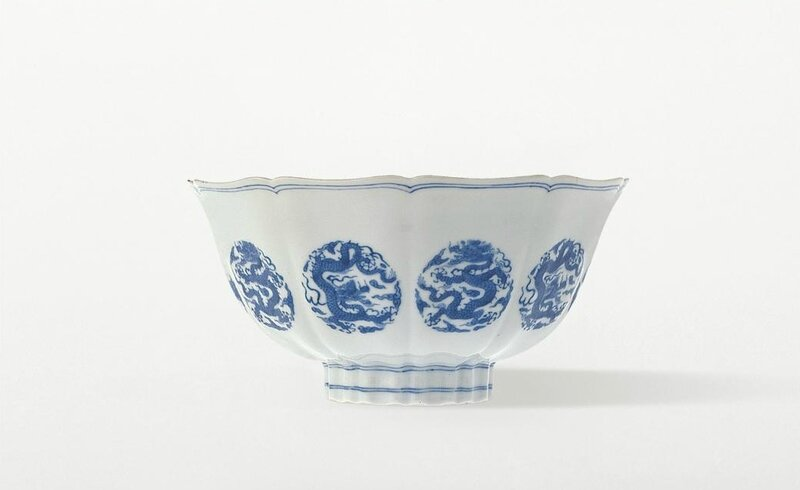 A finely painted blue-and-white Ming-style bowl with dragon medallions, mark and period of Kangxi