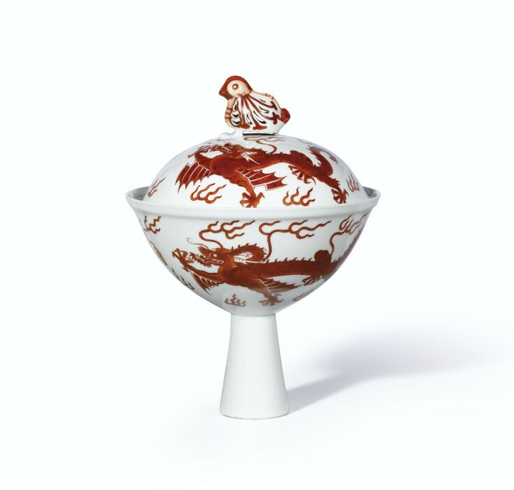 A fine and rare iron-red decorated 'Dragon' stem bowl and cover, Seal marks and period of Qianlong