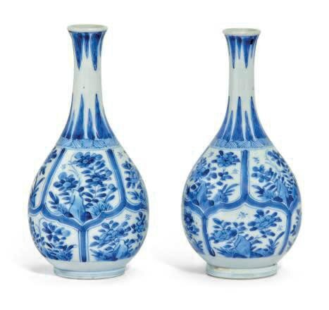 A matched pair of small Chinese blue and white bottle vases, Kangxi period (1662-1722)