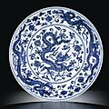 A magnificent blue and white 'dragon' dish. Mark and period of Xuande
