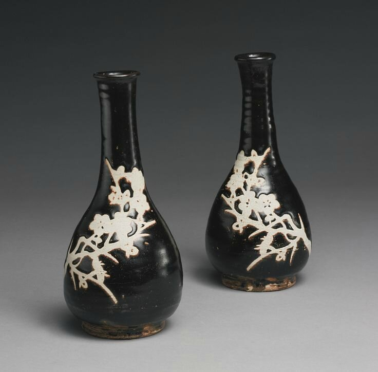 Two 'Jizhou' 'Prunus' bottle vases, Southern Song dynasty