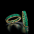 A superb pair of antique emerald bangles