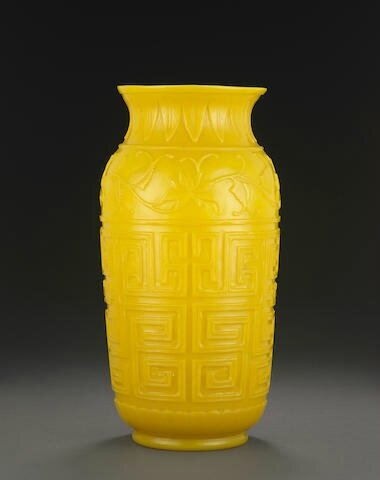 A large carved opaque yellow glass vase, 19th century