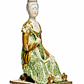 A rare sancai-glazed pottery figure of a court lady, Tang dynasty (618-907)