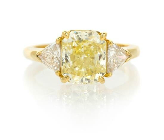 An 18 Karat Yellow Gold, Fancy Intense Yellow Diamond and Diamond Ring, Cartier