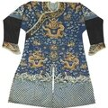 A blue silk ground embroidered dragon robe, late qing dynasty