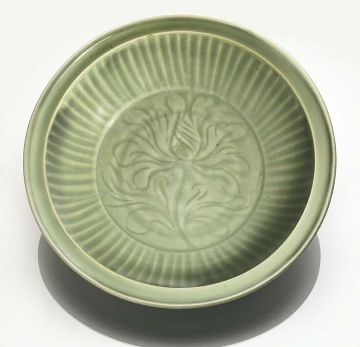 A carved 'Longquan' celadon 'Lotus' dish, Yuan-Ming dynasty