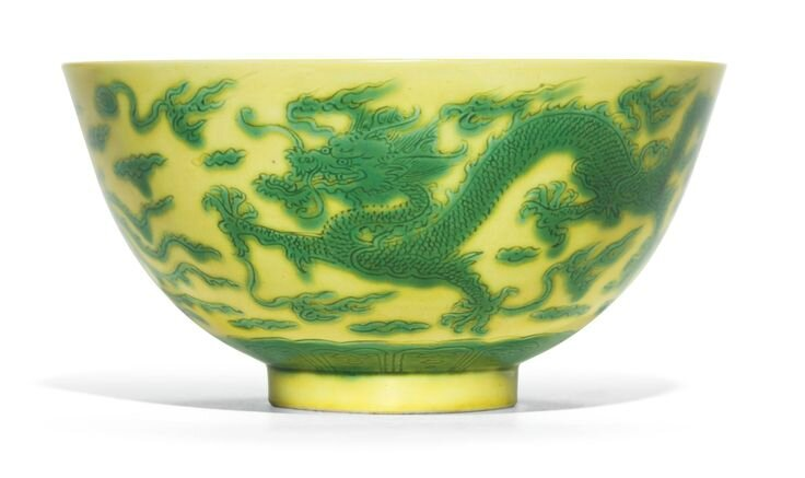 A yellow-ground green-enamelled 'Dragon and phoenix' bowl, Kangxi mark and period
