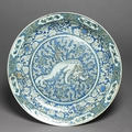 Dish with chinese lion dog, iran, safavid period (1501 - 1722)