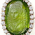 Unusual victorian brooch featuring a 17.0 carat peridot cameo with diamond surround.
