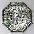 A rare 'open-leg' silvered bronze mirror, Tang Dynasty
