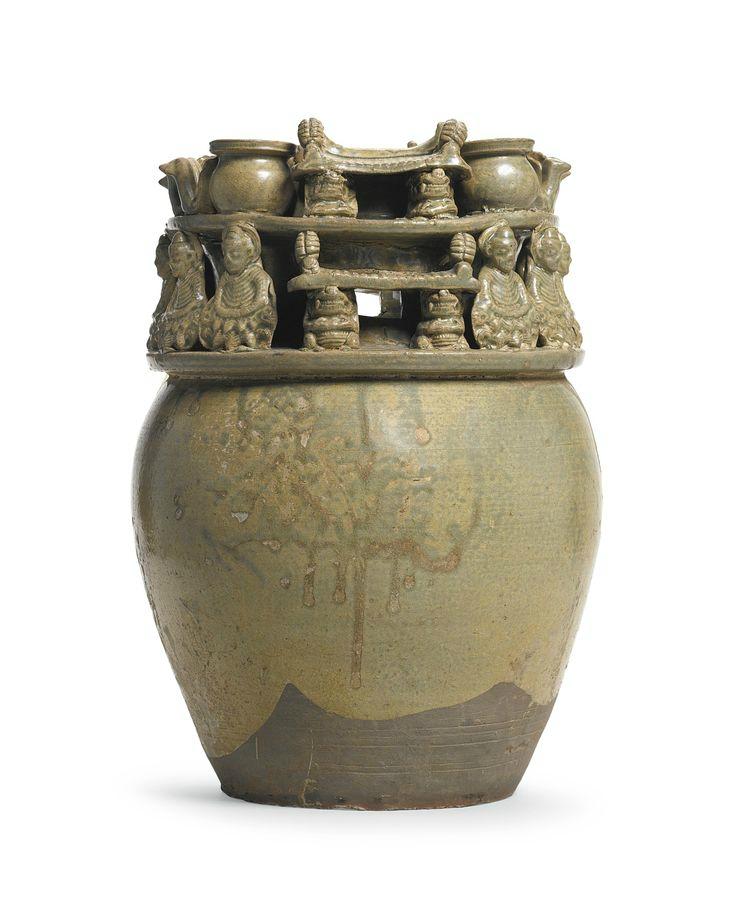 A 'Yue' celadon-glazed funerary jar with buddhist figures, Western Jin dynasty