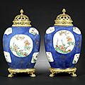 A pair of ormolu-mounted famille verte and powder-blue vases and ormolu covers. the porcelain kangxi, the mounts later probably