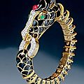 David webb. a beautiful black enamel, ruby, emerald and diamond horse bracelet. new york, circa 1970