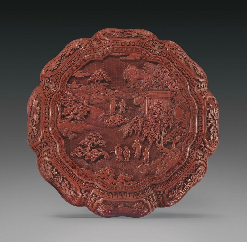 A finely carved cinnabar lacquer octafoil box and cover, Qianlong period (1736-1795)