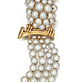 A gold, pearl, diamond and ruby bird clip, circa 1960.
