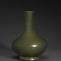 A fine teadust glazed pear-shaped vase, Qianlong six-character impressed seal mark and of the period. Photo Bonhams
