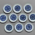 A set of ten blue and white 'crane' saucer dishes, jiajing marks, 17th century