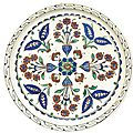 An iznik polychrome pottery dish with stylised floral vase design, turkey, circa 1575-80