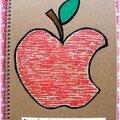 Cahier personnalisé avec une pomme et une citation adhoc