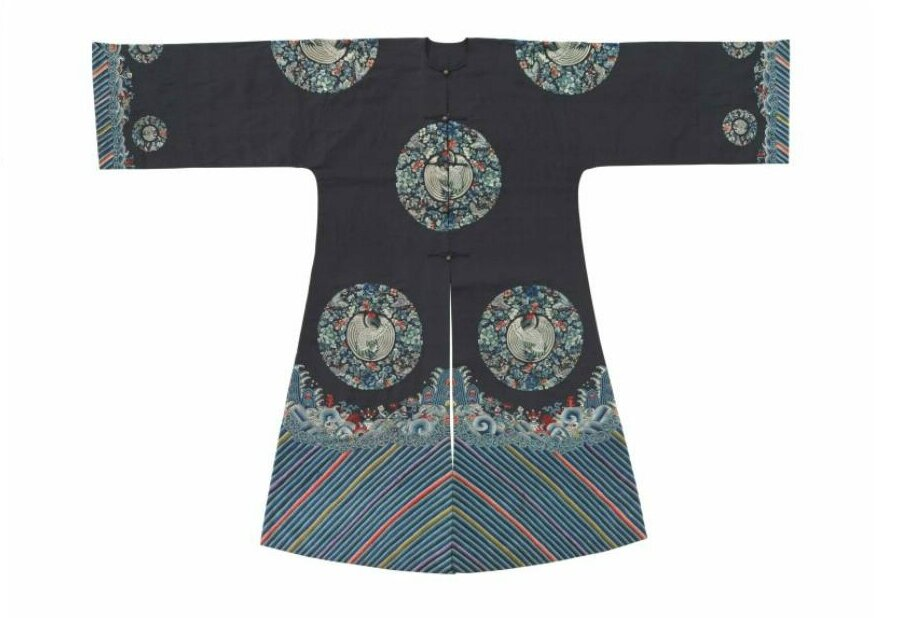 An unusual embroidered midnight-blue-ground surcoat with crane roundels, gua, late 19th century