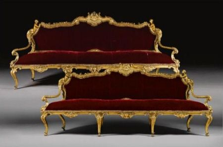 A_pair_of_Italian_carved_giltwood_settees_from_the_Galleria_Dorata_Palazzo_Carrega_Cataldi_
