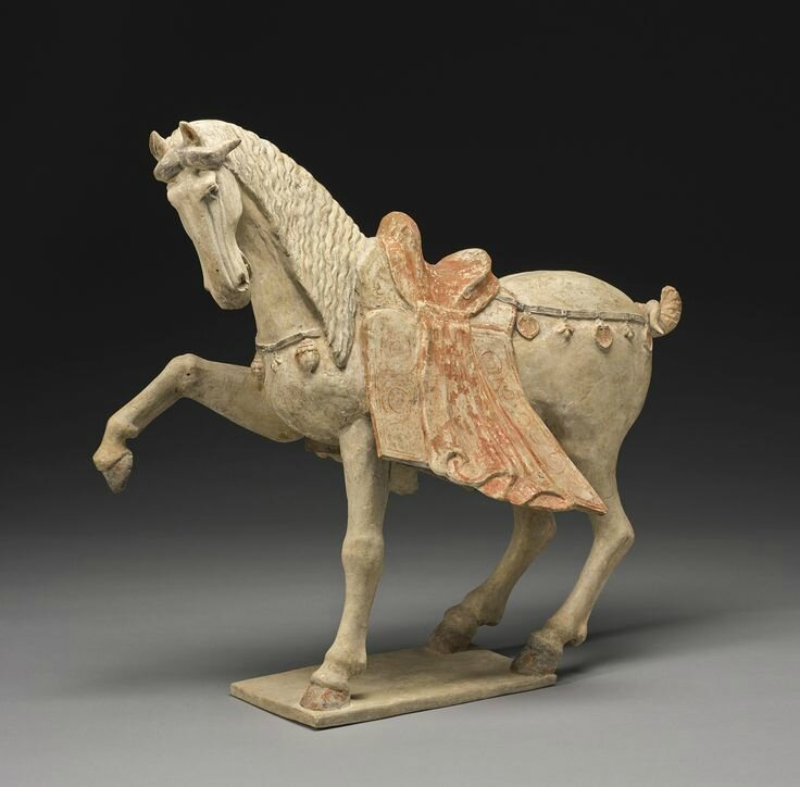 A large painted pottery figure of a prancing horse, Tang dynasty