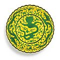 A fine foliate yellow-ground green-enamelled 'Dragon' dish, Seal mark and period of Qianlong
