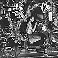 Working inside a printing press at RR Donnelley and Sons, printers of the Montgomery Wards Catalog, 1942, Chicago