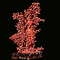 A red coral vase representing richly carved vegetation, fruit and birds, China, beginning 20th century