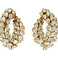 A pair of gold plated platinum and diamond earclips, harry winston