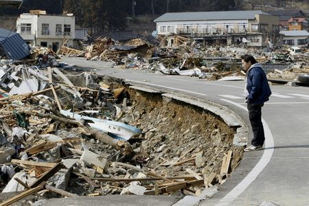 73958_a_man_looks_at_the_damage_caused_by_the_earthquake_and_tsunami_in_ofun