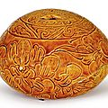 An amber-glazed 'floral' incense stick holder, liao dynasty