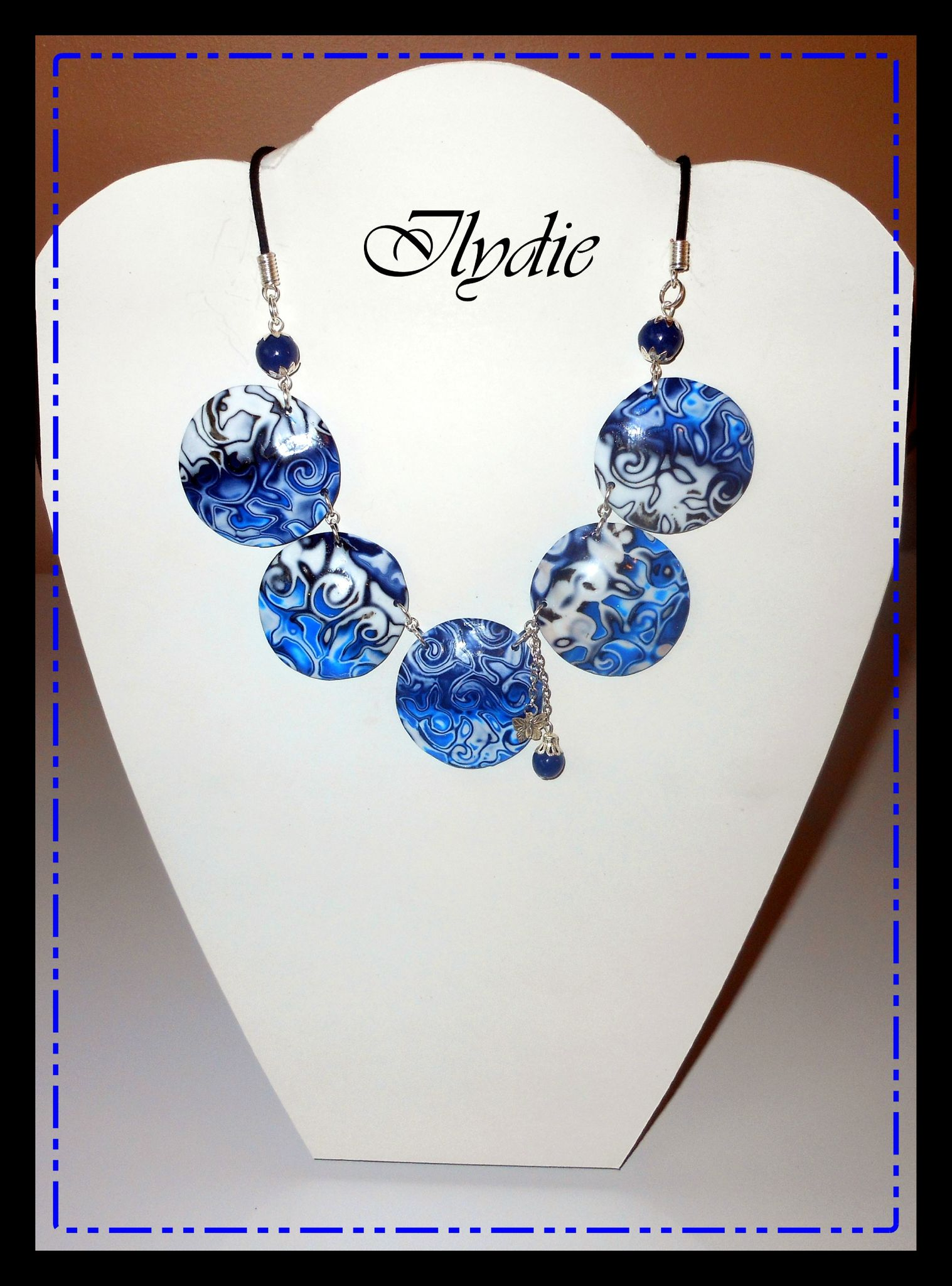 C10 (1) (2012) Collier lentille hidden magic bleu