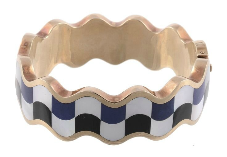 A mother of pearl, onyx and lapis lazuli hinged bangle by Angela Cummings for Tiffany & Co, circa 1980
