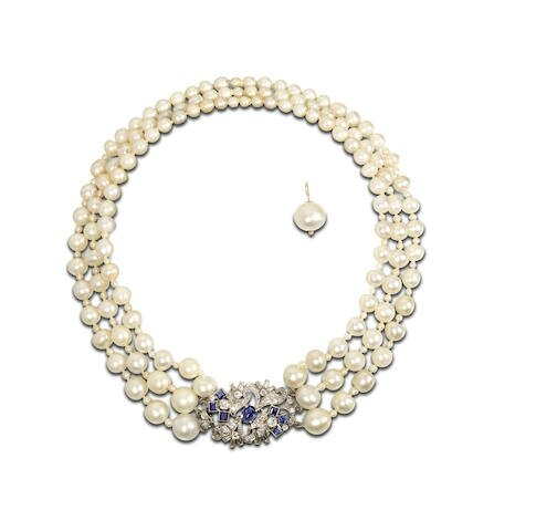A mid 20th century pearl necklace with sapphire and diamond clasp