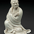 A small Dehua figure of a seated monk, China, Qing dynasty, 17th-18th century