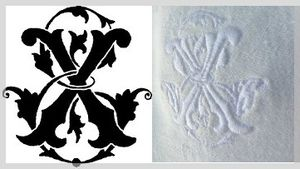 Initiales EX brodées sur serviette de table damassée