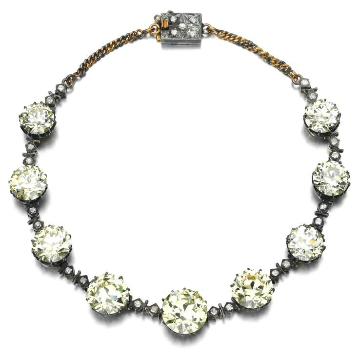 Impressive fancy yellow diamond and diamond necklace